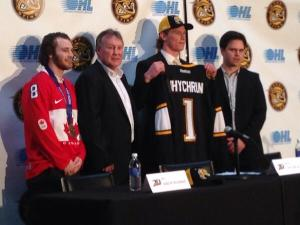 Tyler McGregor (left), Bill Abercrombie (seconod from left), Jakob Chychrun and Director of Scouting Nick Sinclair (right) present Chychrun with his Sarnia Sting jersey (Photo: CHOK)